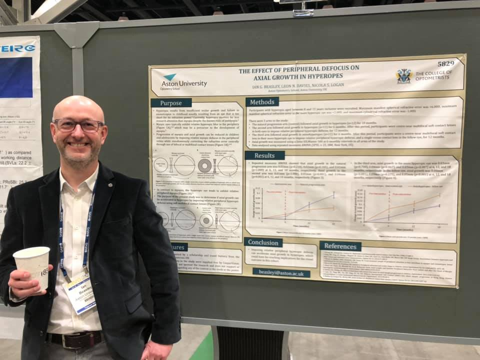"Ian Beasley ARVO 2019, standing in front of his poster titled ""The Effect of Peripheral Defocus on Axial Growth in Hyperopes"""